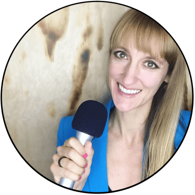 laura-headshot-with-microphone-wood-background circle